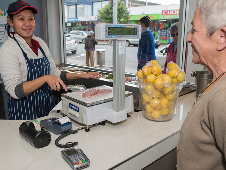 Fishmonger in Papakura with customer.jpg